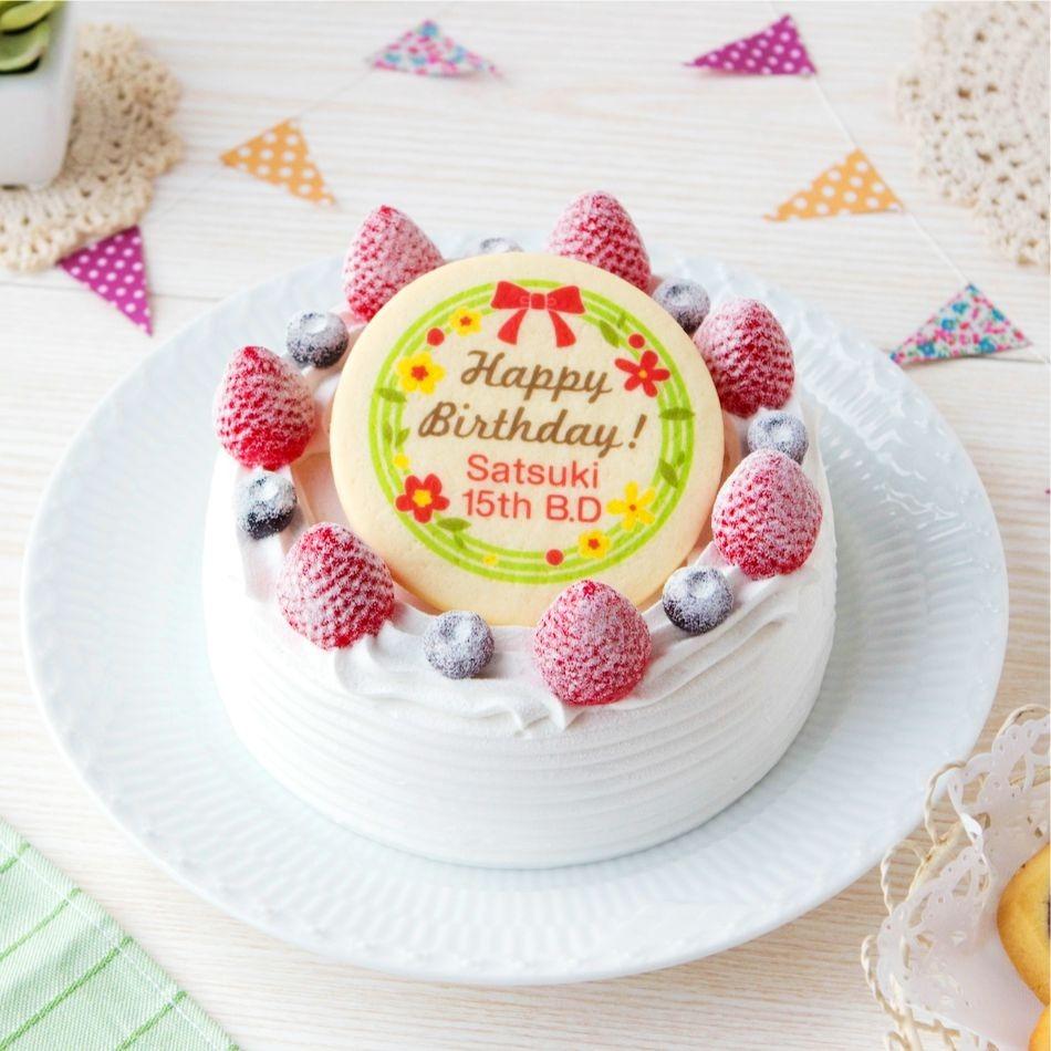 デコレーションケーキの中央に配置された「HappyBirthday! Satsuki 15th B.D.」と印刷されたプリントクッキー